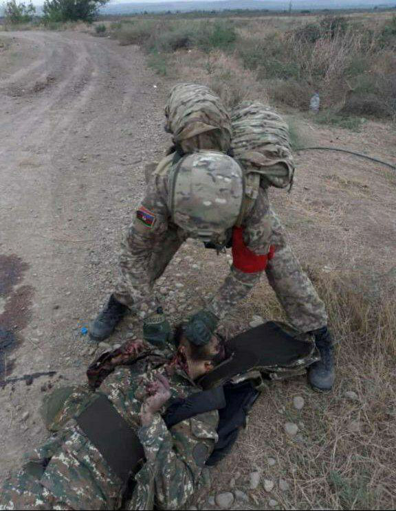 A Photo of Beheading and Mutilation of an Armenian Combatant's Body by an Azerbaijani Combatant
